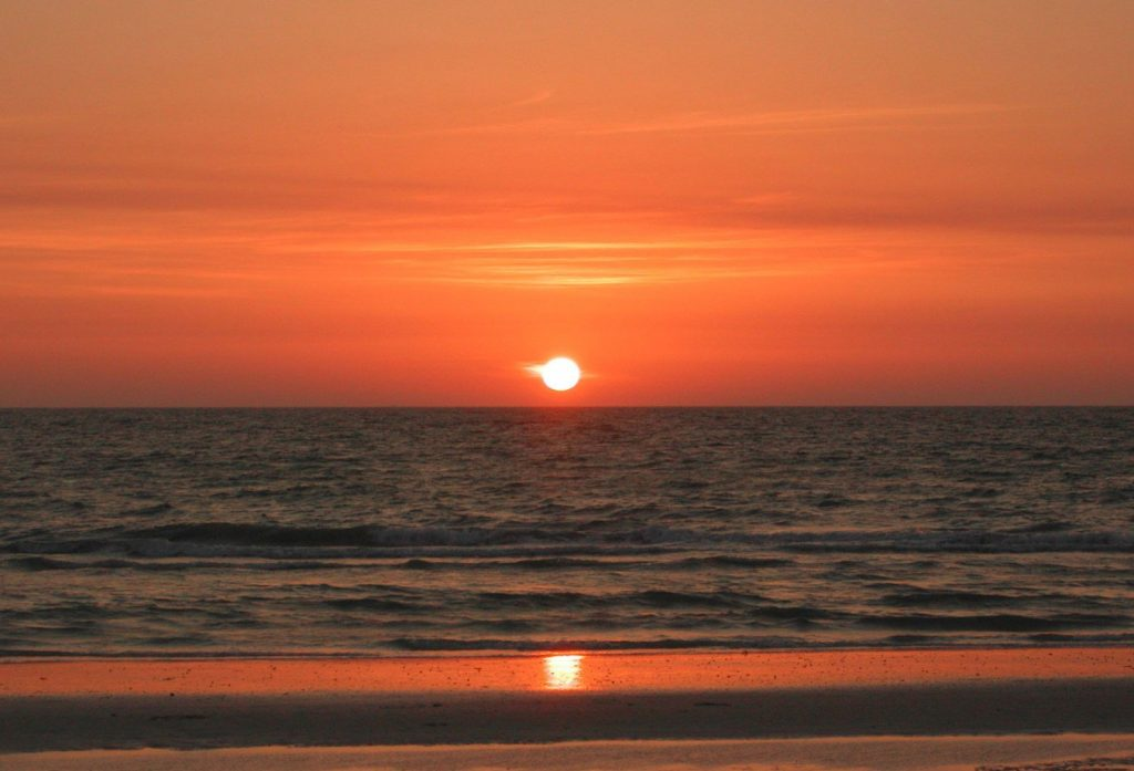 A beach sunset near our Panama City Beach vacation rentals