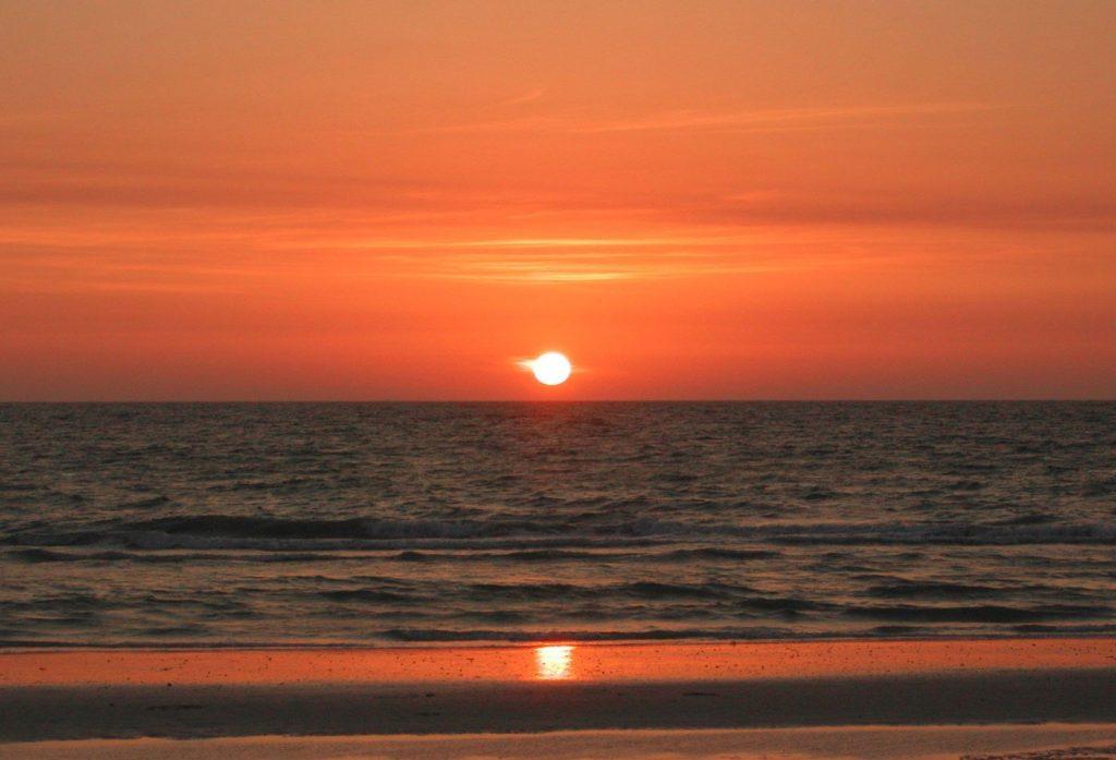 A beach sunset near our Panama City Beach vacation rentals